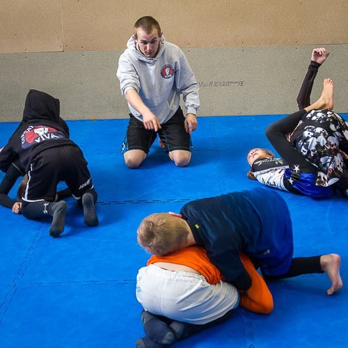 Griff giving instruction in our Kids BJJ class in Tameside