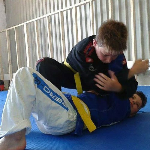 Ethan looking for the submission on luke in our kids BJJ class