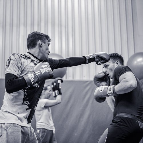Arron throwing the Jab while richard slips in some Kickboxing sparring in manchester