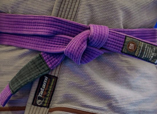 Matt wearing his brazilian jiu jitsu purple belt