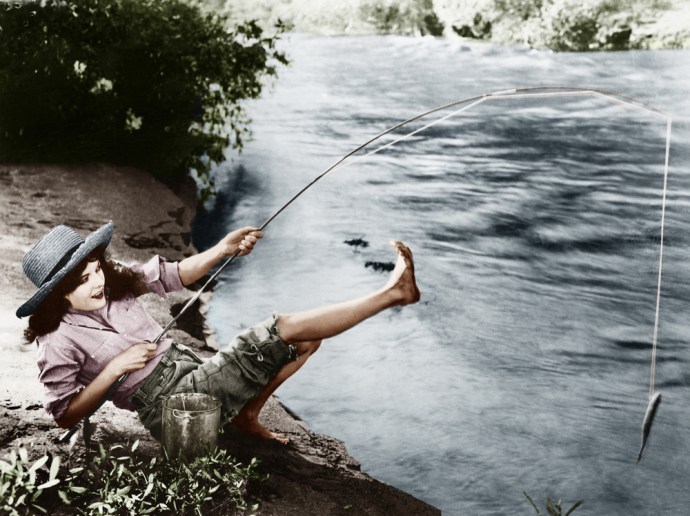 A woman fishing happily