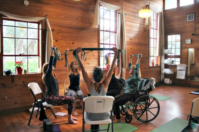 Taking chair yoga training at Heartwood