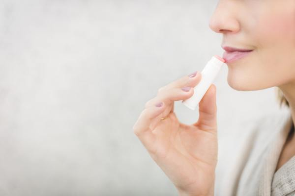 Woman applying chapstick
