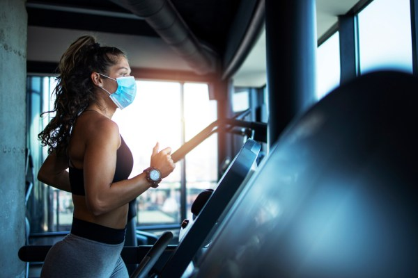 Woman at a gym wearing a mask