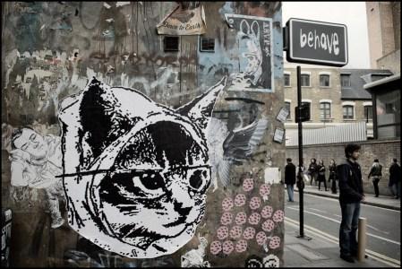Street art in East London, cat face in paper