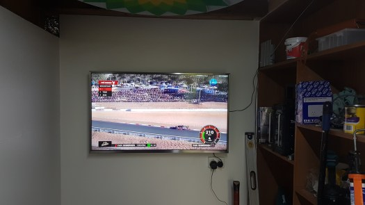 Photo of TV mounted on back wall