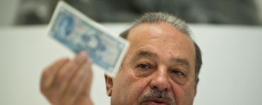Mexican tycoon Carlos Slim speaks during a press conference at the Soumaya Museum in Mexico City, on the eve of its opening to the public, on March 28, 2011. Soumaya Museum, the second opened by Slim, has an investment of more than 800 million dollars and will house over 60,000 works of art form all over the world.  AFP PHOTO/RONALDO SCHEMIDT (Photo credit should read Ronaldo Schemidt/AFP/Getty Images)