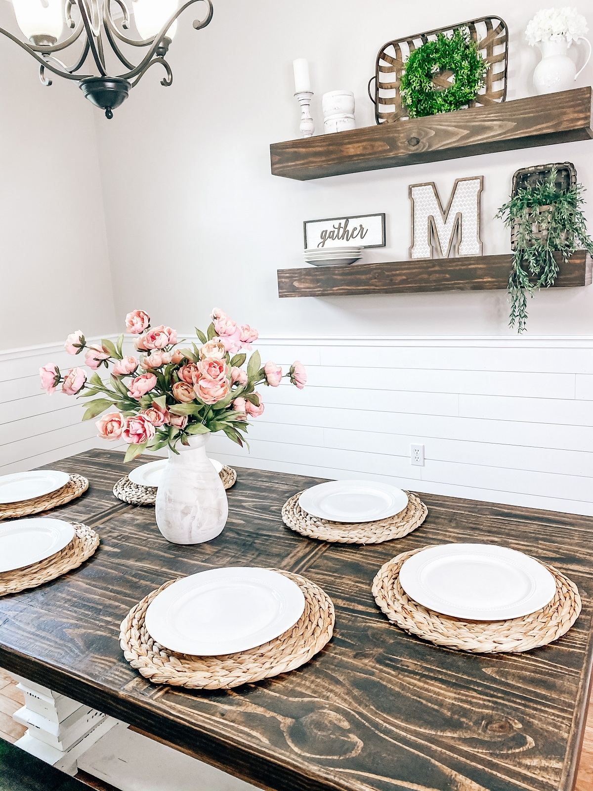 A table setting perfect for the fall with wall décor behind it