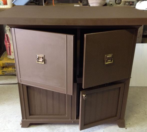 cabinet is now all the same colour, deep brown, and the three pieces of hardware all match
