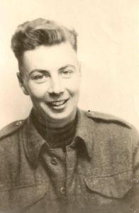 Derek's Dad, wearing his uniform and a broad smile.