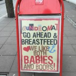 Sign reads: Go ahead and breastfeed. We like both babies and boobs!