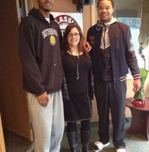 I'm dwarfed by two giant basketball players, one of whom's head was cut off by the photographer.