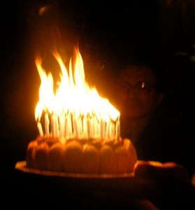 birthday cake with candles burning in a huge flame