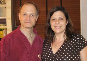 David Hyde Pierce wearing a burgundy bathrobe and me in a dress, brown with white polka-dots