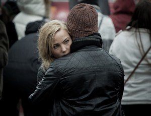 a sad woman gets a hug from a friend