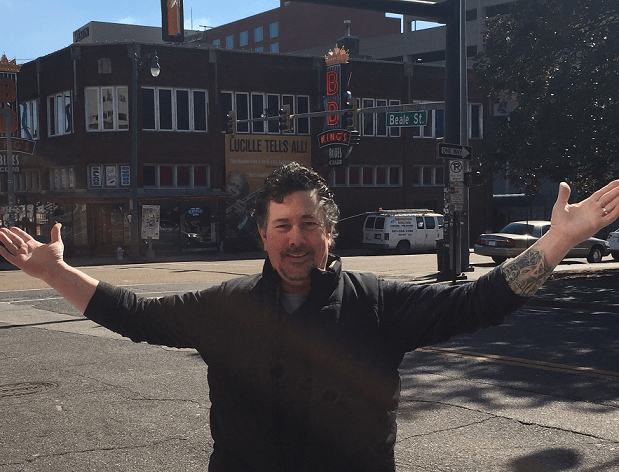 Derek under the Beale St sign in front of BB King's Blue Club