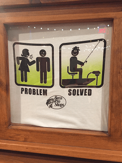 "T shirt shows a stick figure woman yelling at a stick figure man. Underneath it says ""problem"". In the next box the stick figure man is fishing. Underneath it says ""solution""."