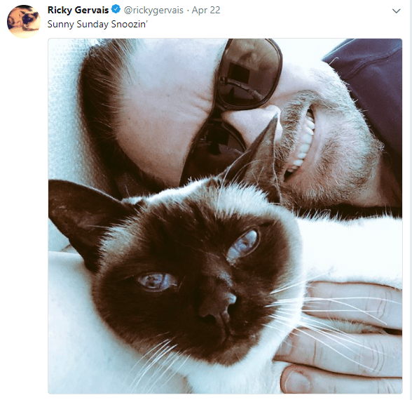 a photo of Ricky and his Siamese cat Ollie