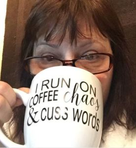 Drinking from my new mug that reads: I run on coffee, chaos and cuss words!