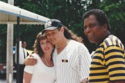 Neal McCoy hugs a female fan for a photograph while Charley Pride smiles