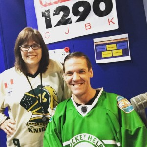 Ken and I wearing London Knights jerseys, posing in the studio in front of the CJBK sign