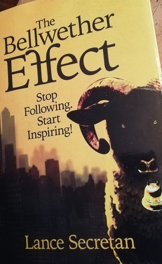 book cover. Yellow with black lettering and the face of a ram