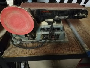 photo of a belt sander on a table