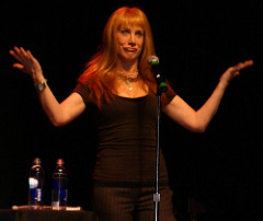 "Kathy Griffin making an ""uh-oh"" face while performing on stage"