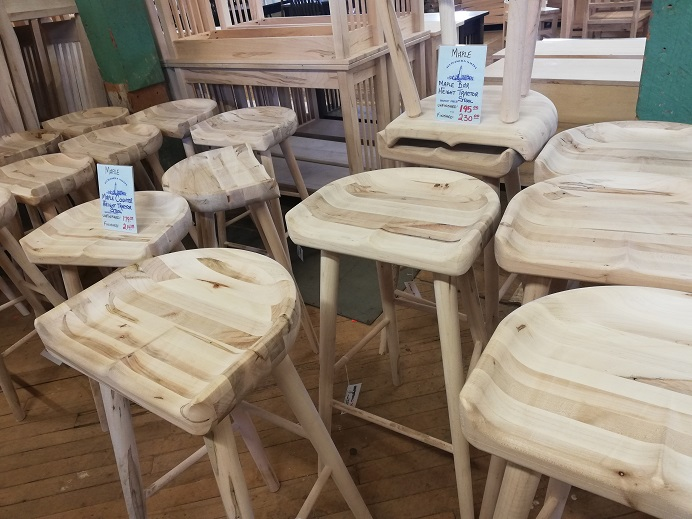 Tractor stools are wooden stools that are grooved to cradle the butt.