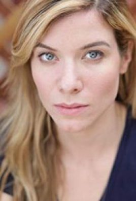Closeup of actress Tessa Ferrer, long blond haired 30-something woman.