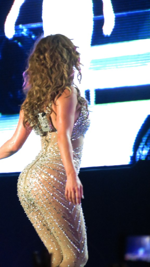 J-Lo's butt during a performance, covered in a see-through glittery catsuit.