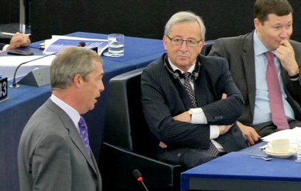 Nigel Farage (L), British Member of the European parliament and leader of the UK Independence Party (UKIP), speaks while Jean-Claude Juncker (C), candidate for President of the Commission looks on during the plenary session in the European Parliament in Strasbourg, France, 15 July 2014. Daily Mail grab Sky News