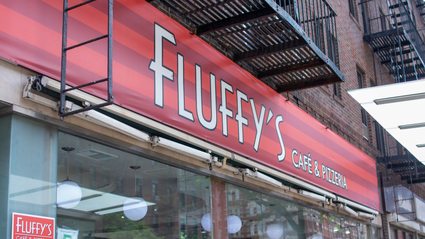 Outside sign of fluffy's cafe in new york