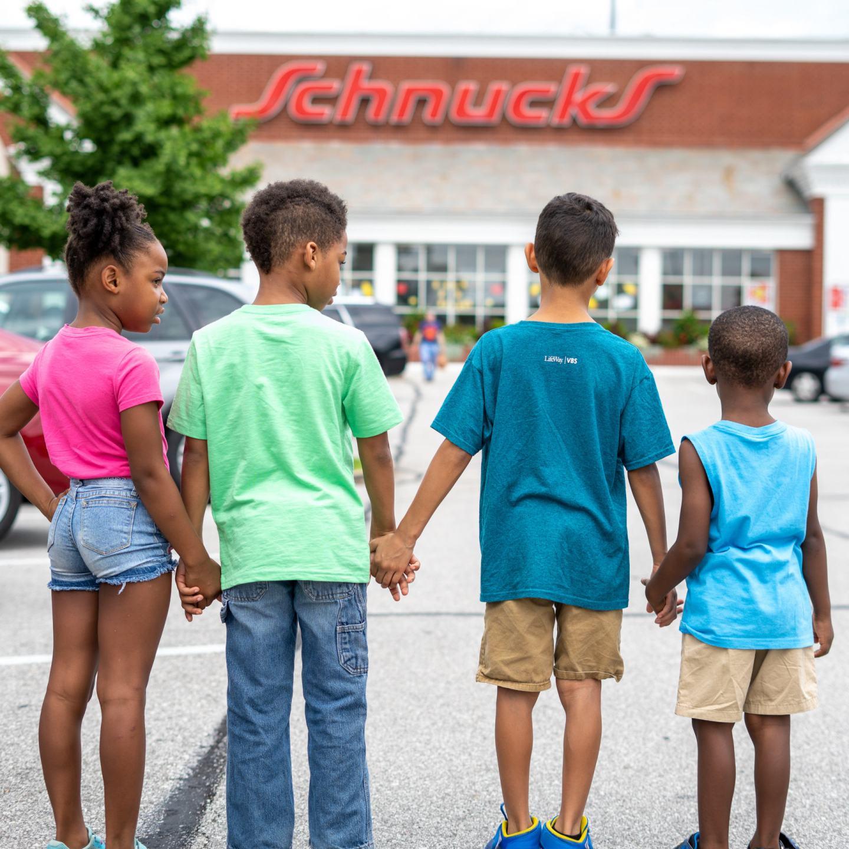 vera's kids walking into ladle schnucks grocery store