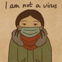 "A woman wearing a mask. The image includes the phrase ""I am not a virus"""
