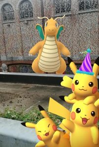 Dragonite and Pikachus infront of an old building with the text of Thomas Moore's Utopia painted on it
