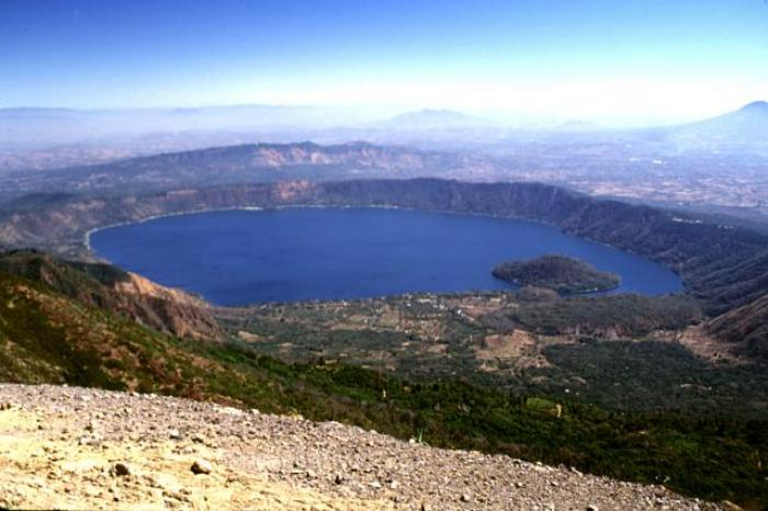 Coatepeque Caldera crater lake, El Salvador. Here, it is easy to see where the volcano used to be and how it collapsed into its own magma chamber. (Lee Siebert, 2002, Smithsonian)