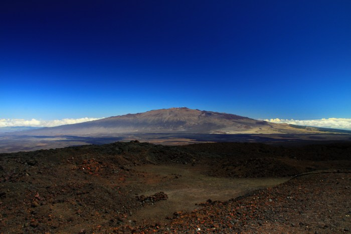 Over twice as tall Mount Everest, the shield volcano Mauna Kea rises almost 10 km from the ocean floor and has a prominence of 4,205 m as measured from sea level. Because of the low gradient of shield volcanoes, you would be hard put to to tell which was up and which were down standing on the lower slopes. (WikiMedia)