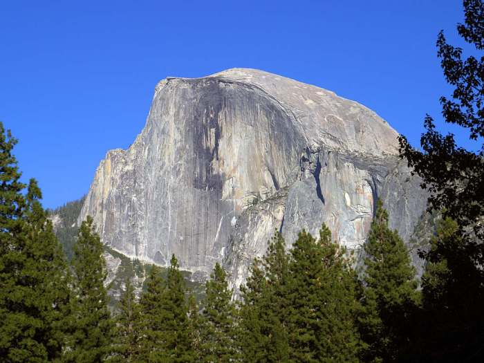 Half-Dome at Yosemite National Park, California. This spectacular granite outcrop is the result of a magmatic intrusion that never reached the surface, a cryptodome. Millions of years of erosion has removed the overlying rocks to reveal this splendid example of a Pluton. (WikiMedia)