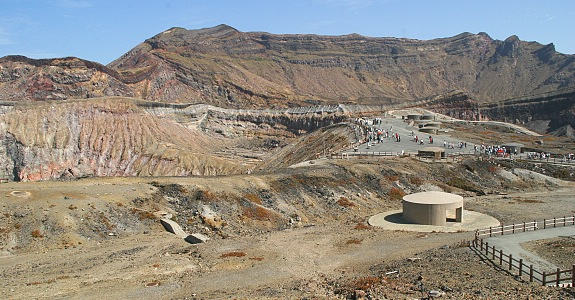 "Tourist facilities inside the spectacular crater of Mt Nakadake. A notice on the website informs the visitor that ""Due to increased volcanic activity, a no-entry zone is currently maintained that stretches one kilometers from the crater and results in the closure of the ropeway, road and hiking trails to the crater. It is currently not possible to see the crater."" (japan_guide.com)"