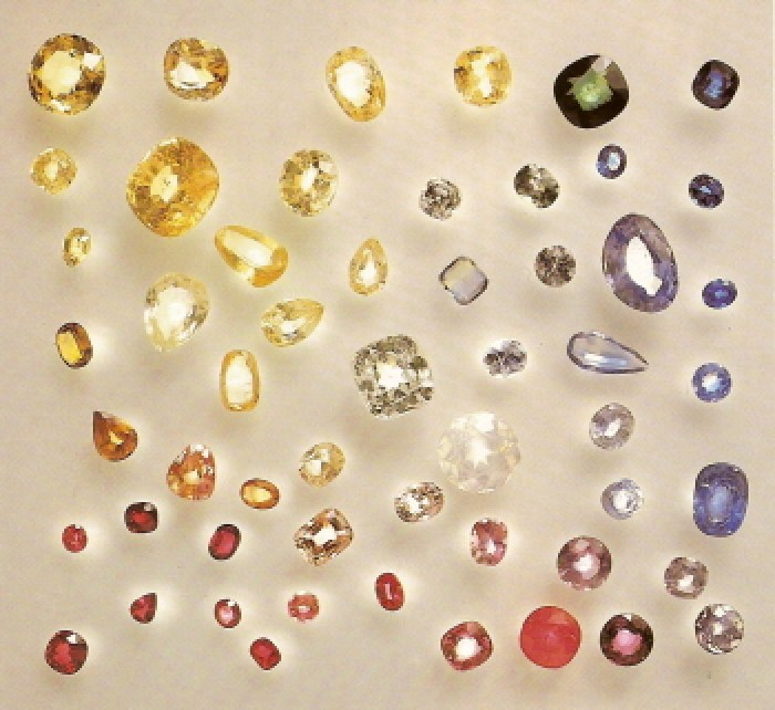 The allochromatic colours of corundum (Al2O3): Ruby – red, Sapphire – blue, all others are designated [colour prefix] + sapphire, eg. pink sapphire, yellow sapphire, colourless sapphire, green sapphire. While pure corundum is colourless, the red colour comes from minute amounts of chromium and the blue from a titanium-iron biparticle, which replace some of the aluminium. Even if the colour of pink sapphire comes from chromium, the colour is not saturated enough to merit the designation ruby. (Gemstones, Geological Museum)