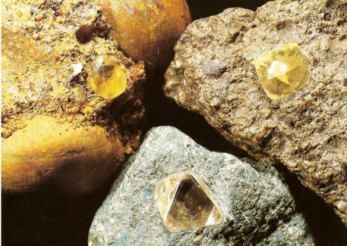 To carry on from Albert's article on diamond, cubic diamond crystals in from left to right: beach conglomerate from Namaqualand (left), kimberlite from Siberia (bottom) and kimberlite from South Africa (right). (Gemstones, Geological Museum)