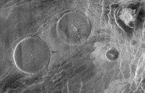Three pancake domes. Note the small central holes. The image is roughly 200 km.