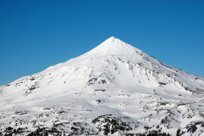 Being the smallest of the Three Sisters, Middle Sister or Faith has suffered some glacial erosion that has cut away parts of its Eastern face. (http://vulcan.wr.usgs.gov)