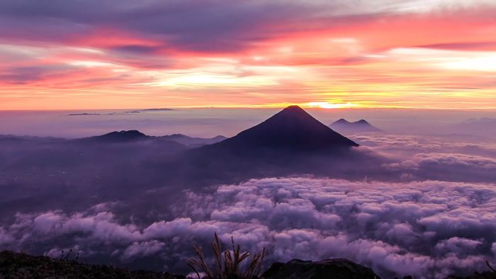 Agua and Pacaya through the clouds. How we normaly perceive volcanoes.