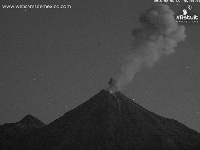 Strombolian explosion at dawn at Mexico's Colima de Fuego in February 2016. Can anyone identify the stars visible in the picture? (Webcams de Mexico)