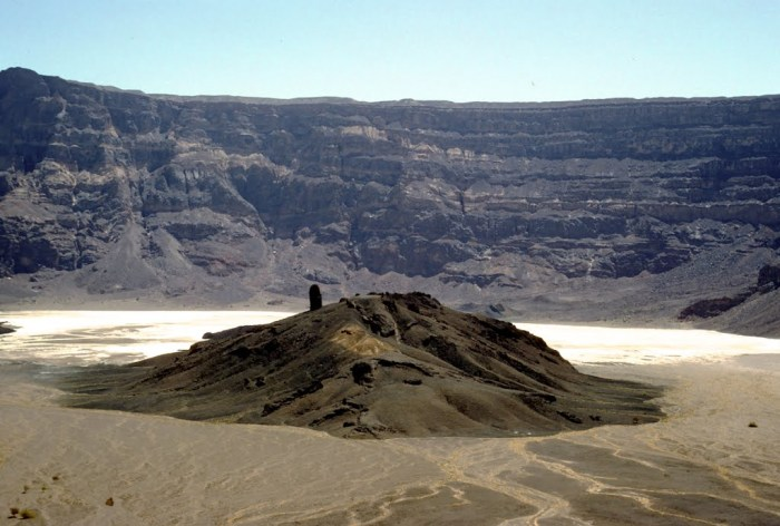 Trou au Natron Caldera with the natron deposits behind a trachyte lava dome. Remnants from a minor 45 cubic kilometer eruption. Photograph by Alain Beauvilain.