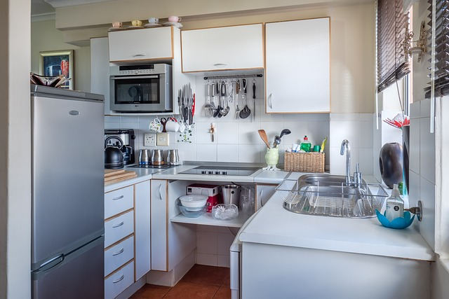 A kitchen with microwave oven