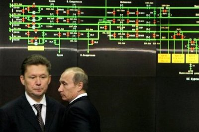Russian Prime Minister Vladimir Putin, right, and gas monopoly Gazprom CEO Alexei Miller, left