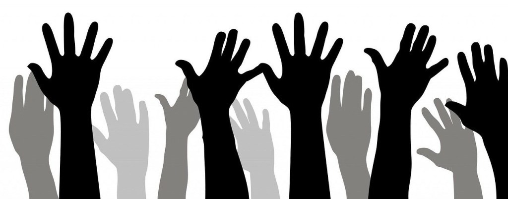 Silhouettes of hands raised
